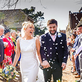 Royal Chapel Windsor Wedding Harry & Libby laugh during confetti throwing