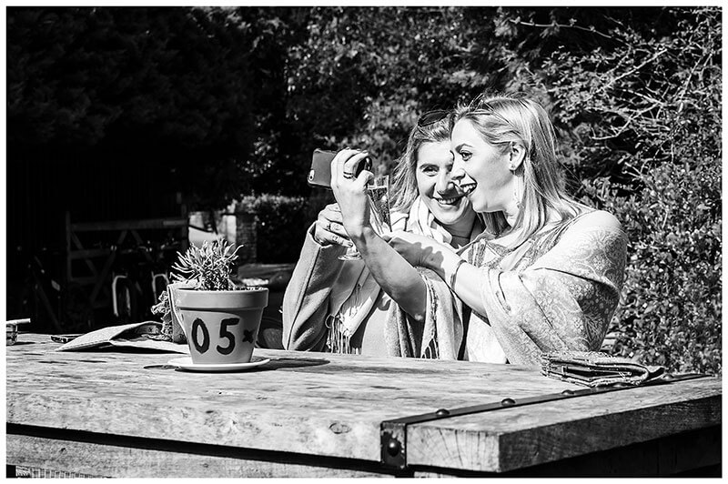 two ladies taking a selfie in the pub garden