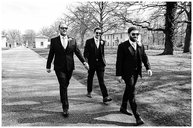 Groom and ushers walking to Royal Chapel Windsor Great Park