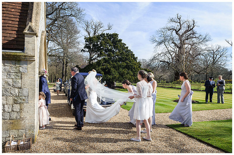 Bridal Party in a line start to enter Royal Chapel Windsor Great Park