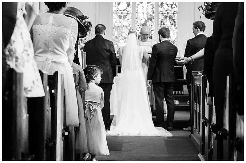 Flower girl distracted during wedding ceremony at Royal Chapel Windsor Great Park
