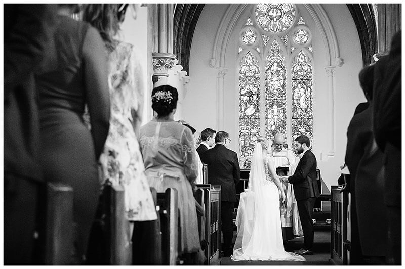 Exchange of vows during lower girl distracted during wedding ceremony at Royal Chapel Windsor Great Park wedding ceremony