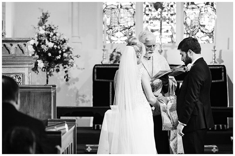 Greek Orthodox blessing during wedding ceremony at Royal Chapel Windsor Great Park