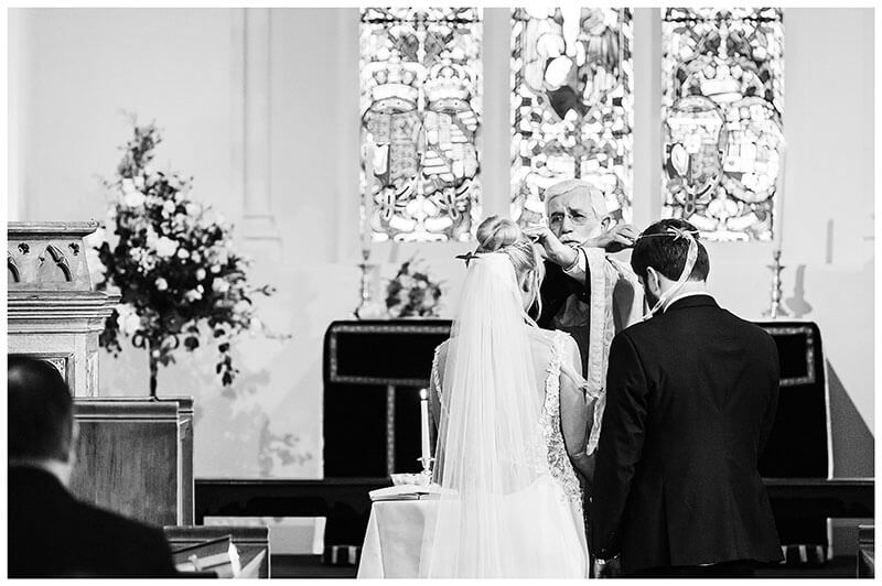 Greek Orthodox Wedding Ceremony swapping of crowns at Royal Chapel Windsor Great Park
