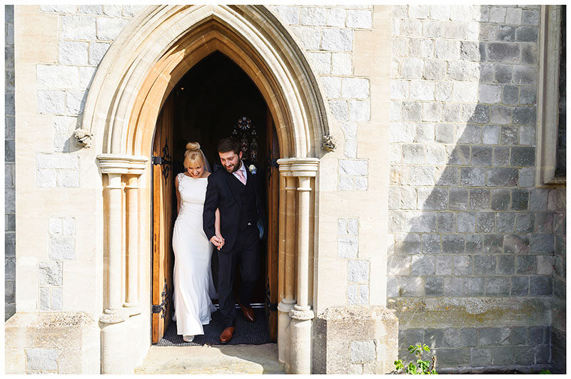 Bride groom exit chapel after wedding ceremony at Royal Chapel Windsor Great Park