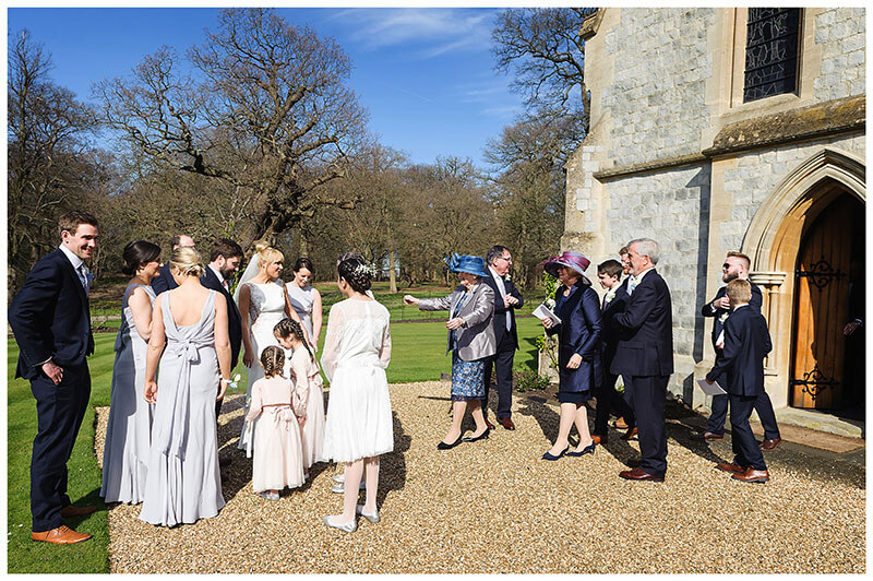 Outside Royal Chapel Windsor Great Park bridal party congratulate bride groom