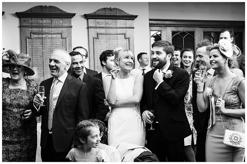 Bride groom and guests laughing at father of the Brides Speech