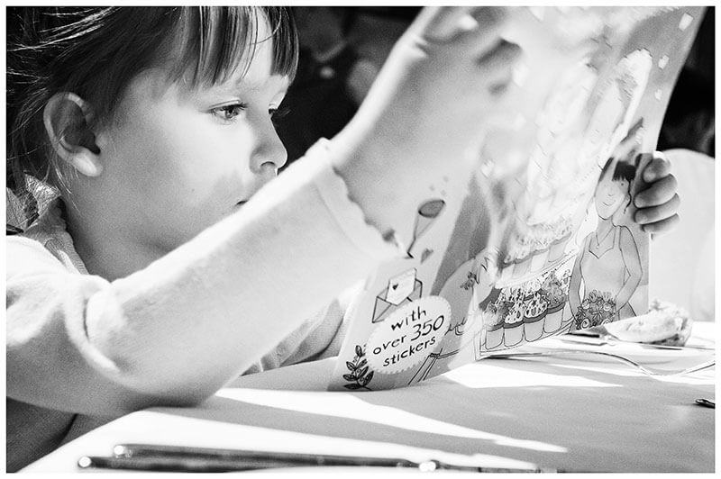 Flower girl reading a colouring book