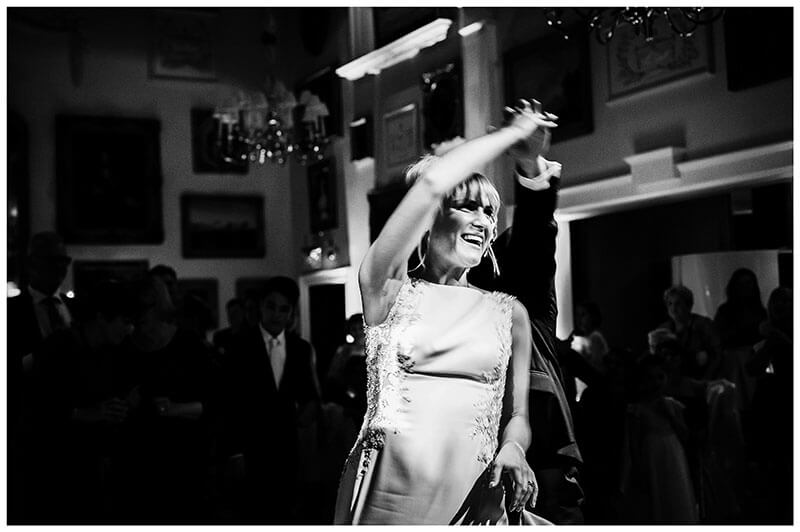 smiling Bride does a twirl during first dance at Wentworth Club golf course