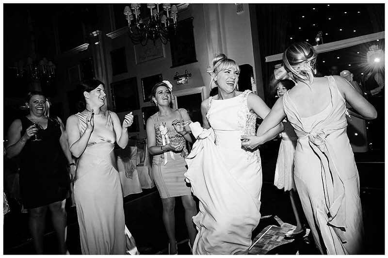 Bride enjoying a dance with her bridesmaids