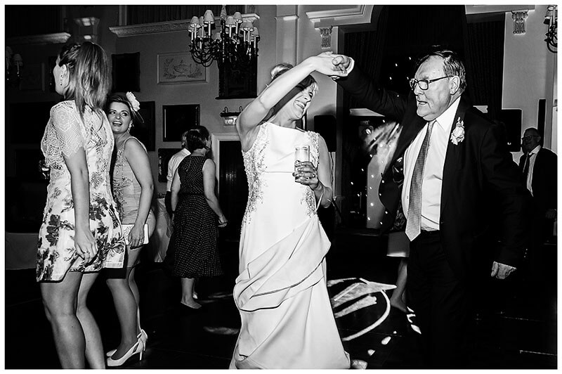 bride does a twirl while dancing with her father