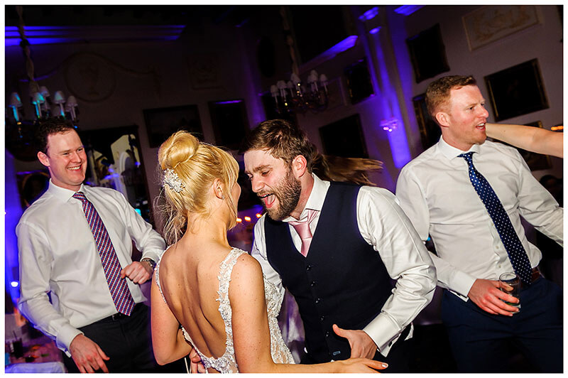groom while dancing with his bride sings to her