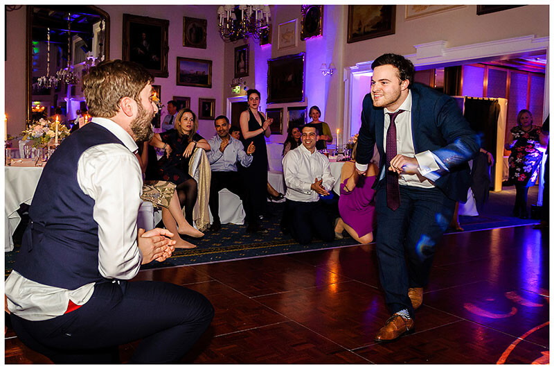 Groom and male guest dance off