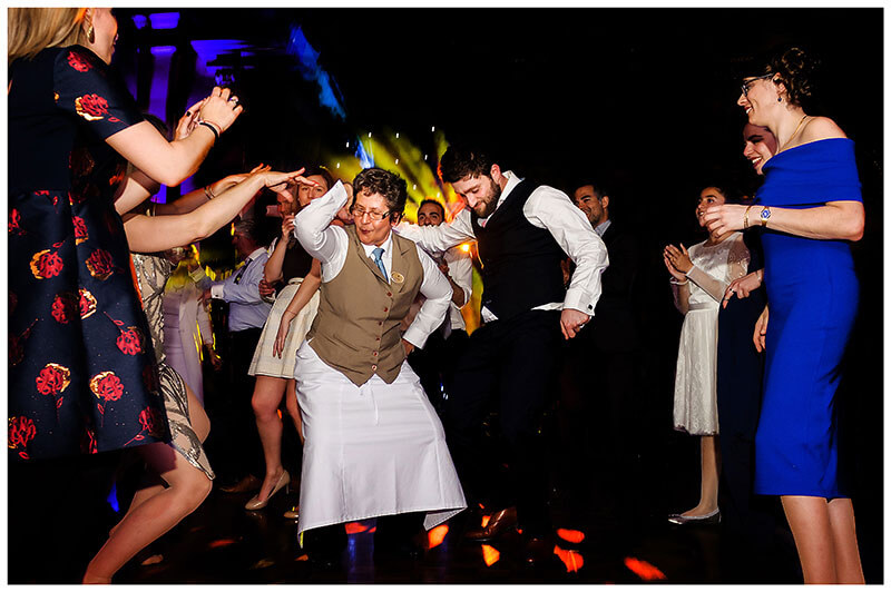 groom dancing with waitress