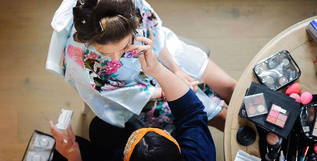 Creative Cambridge wedding photographer bride having make up done viewed from above bride wearing blue kimono
