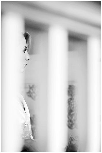 Bride through stair railings during getting ready