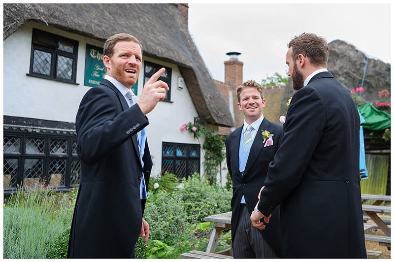 groom and ushers waititng outside pub in Chrishall Cambridgeshire Village
