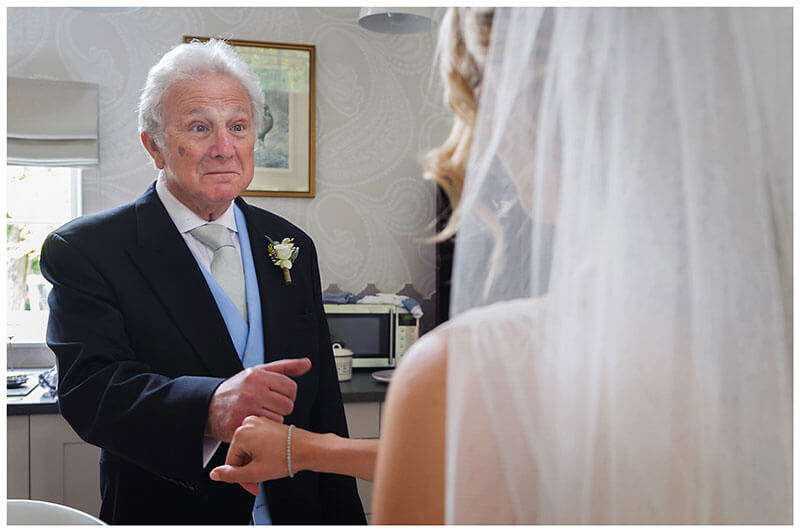 Bride and father greet each other
