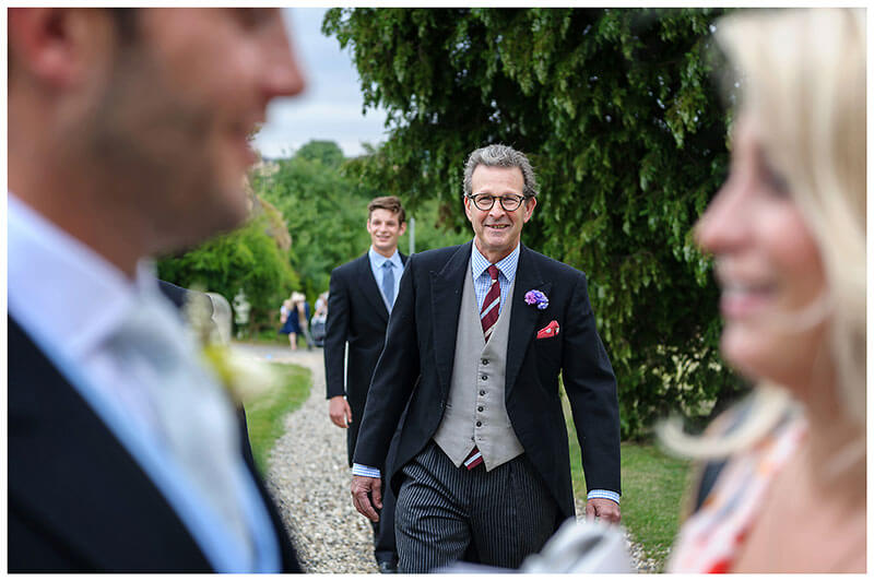 approaching male guest in morning suit at Chrishall Cambridgeshire Village Wedding