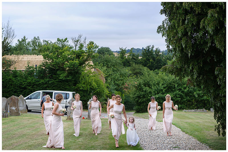 Bridesmaids arriving at the church in Chrishall Cambridgeshire Village
