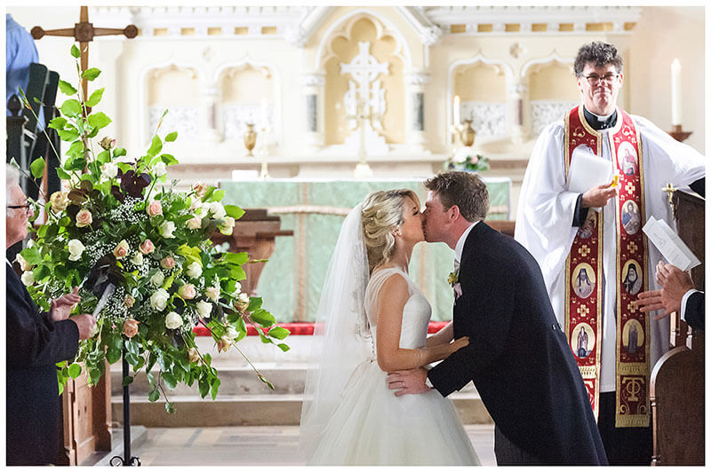 Bride groom kiss at end of wedding ceremony