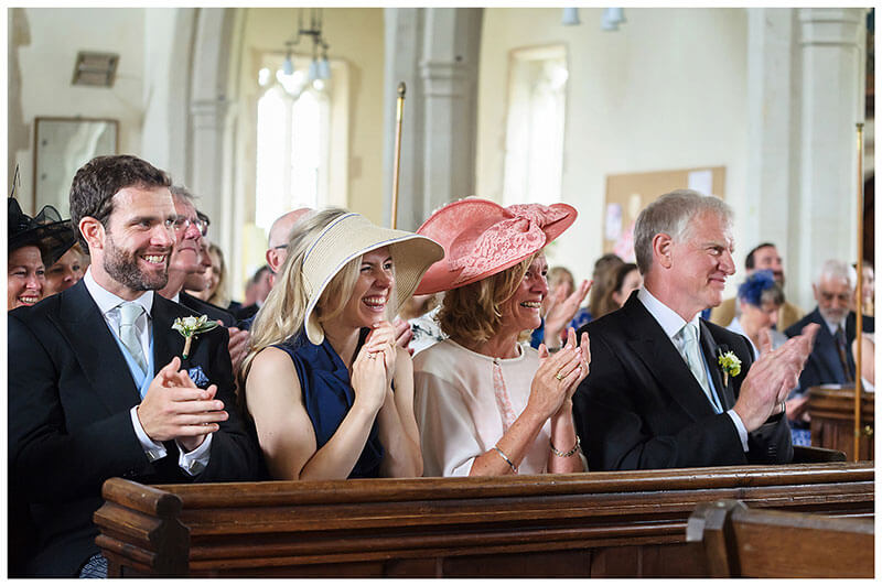 guests applaud at end of wedding ceremony