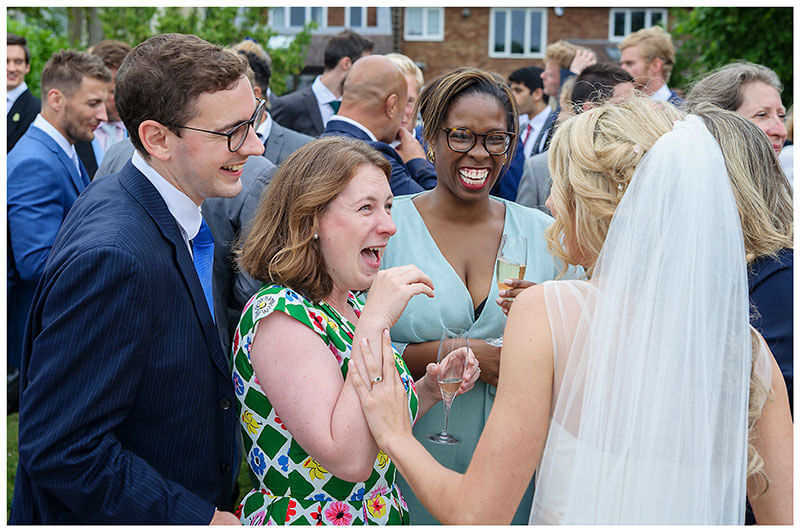 look of joy on guests faces as they talk to bride