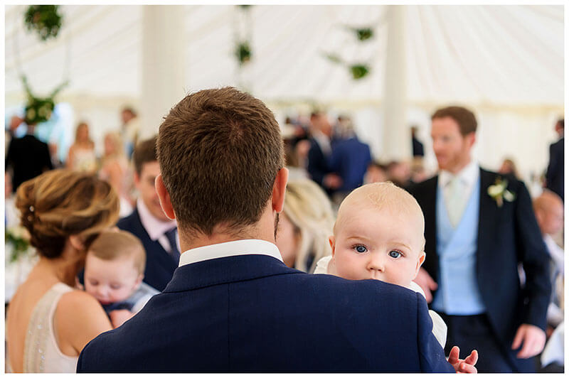 Baby looking over fathers shoulder