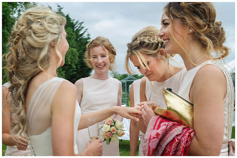 bridesmaid looking at brides wedding ring