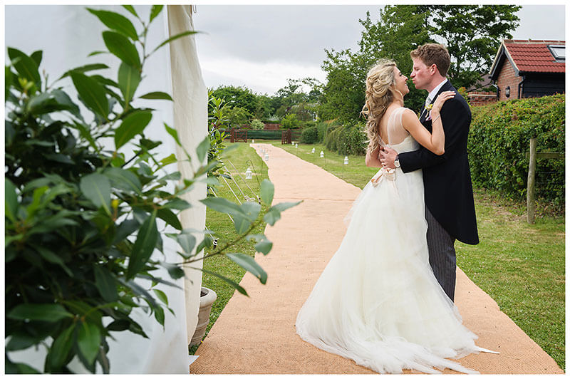 bride groom embrace outside marquee