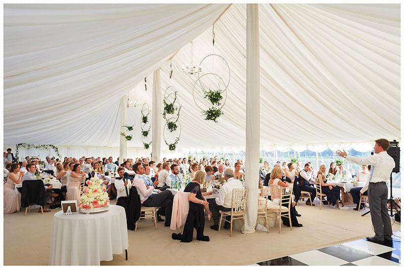 Marquee, cake during grooms speech Chrishall Cambridgeshire Village Wedding