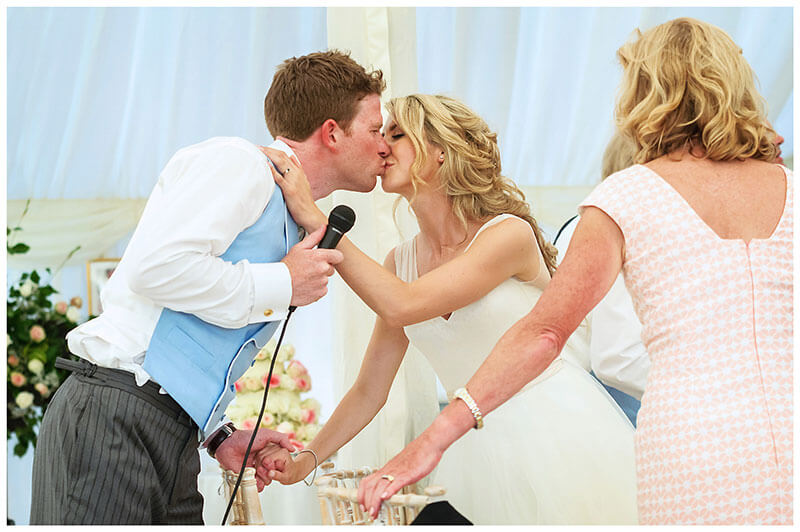 Bride kisses groom after his speech