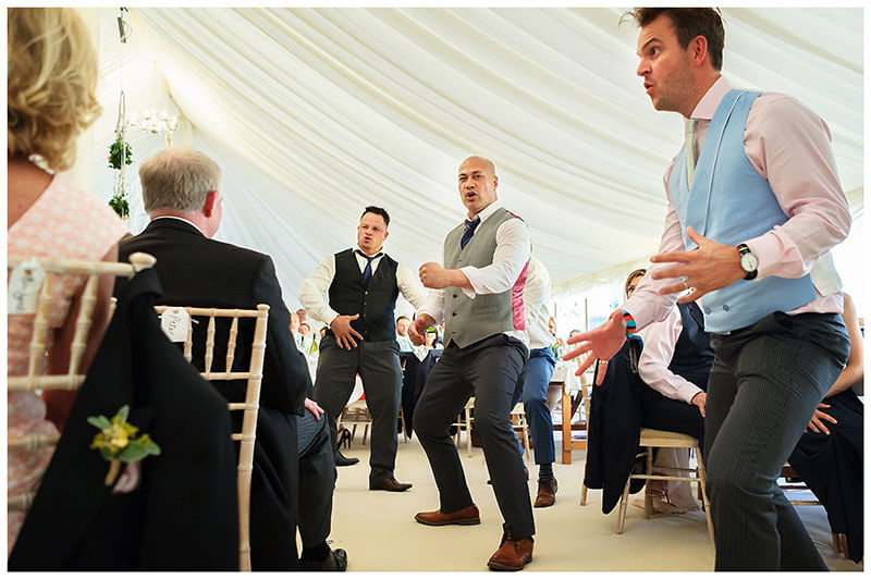 three male guests do hacker for wedding party at Chrishall Cambridgeshire Village Wedding