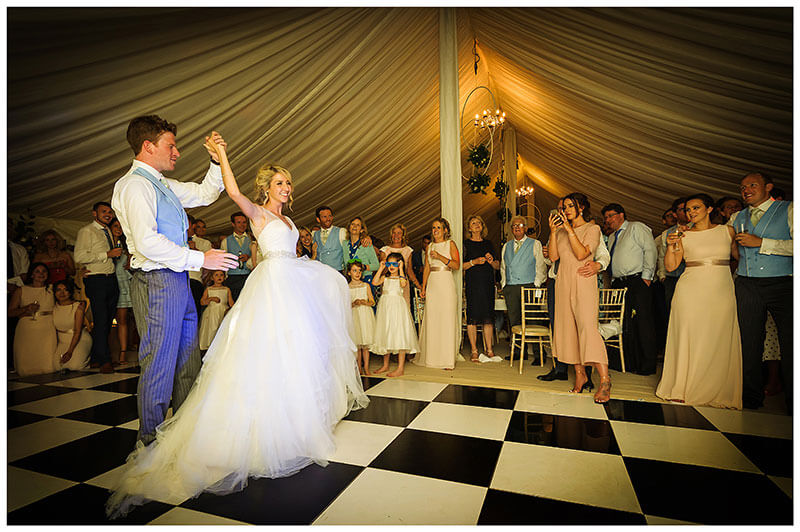 Bride groom being watched by guest as they go through their first dance routine