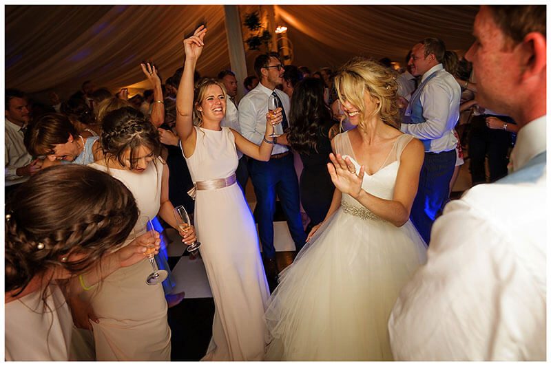 Bride and groom dancing with bridesmaids