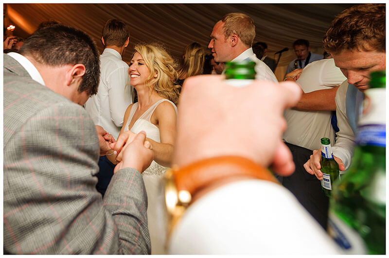 Just about engough room on the dance floor to carry two bottles of beer as bride dances with male guest