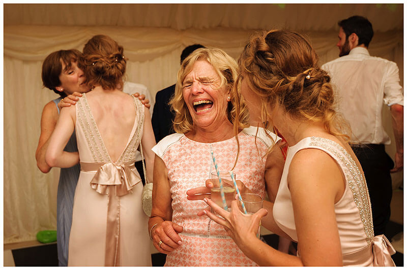 Lady having a good laugh on the dance floor with bridesmaid during Marquee Wedding reception