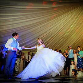 Cambridgeshire Village Wedding Ed & Natasha lovely first dance watched by guests old and young in a marquee