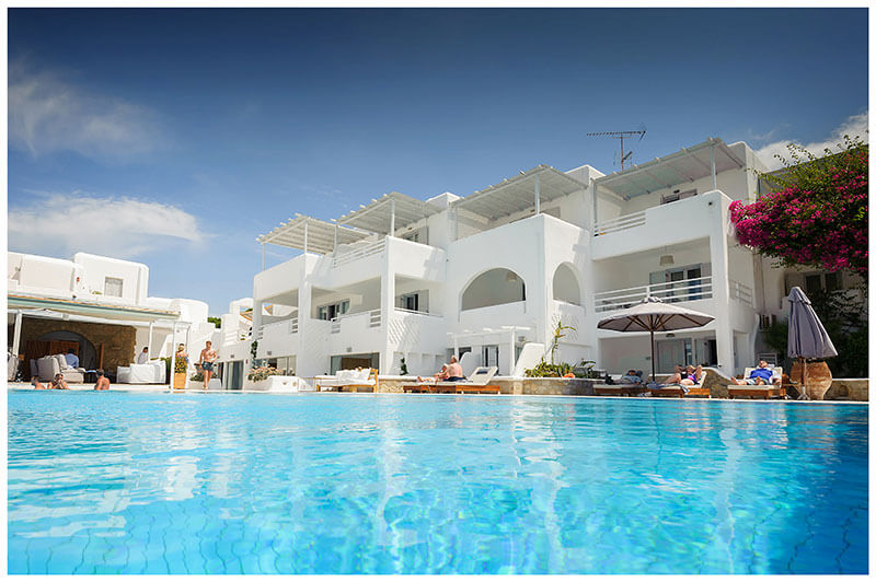 Andronikos Boutique Hotel Mykonos guests around the pool