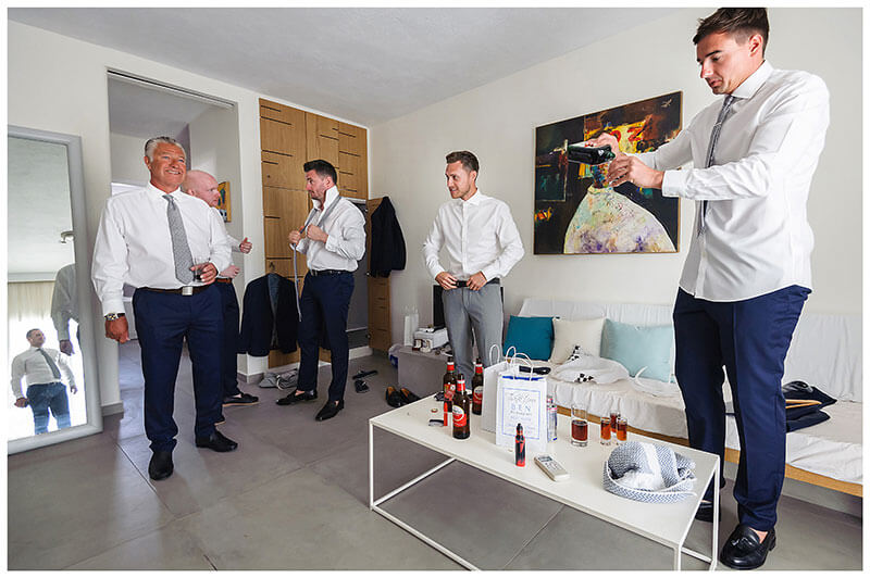 Pouring out the jagermeister for the guys during grooms prep at Mykonos Town Andronikos Boutique Hotel