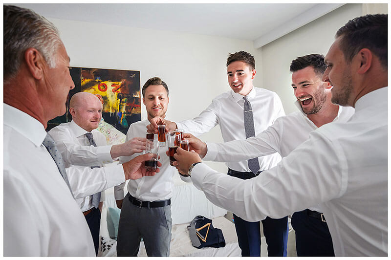 Cheers for the groom at Andronikos Boutique Hotel Mykonos