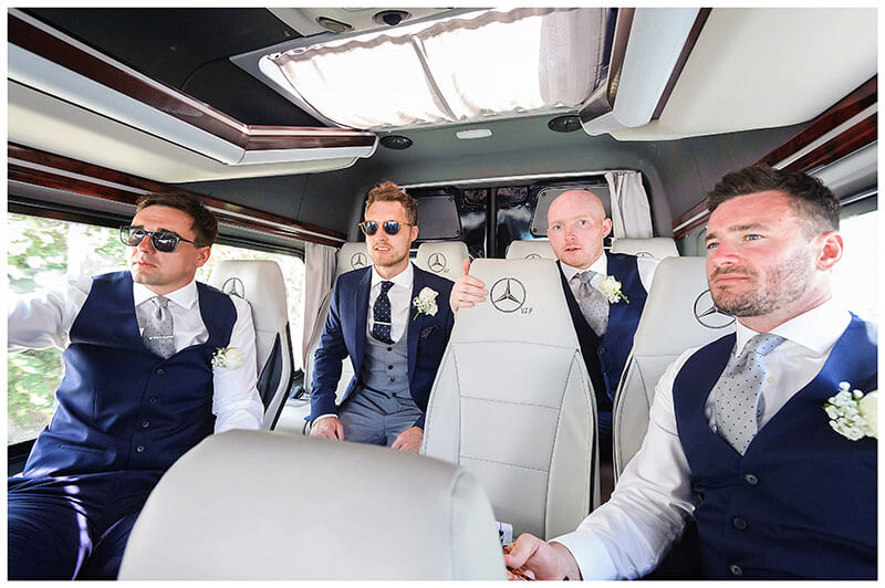 Groom and ushers in transport on way to Royal Myconian Resort for the wedding reception