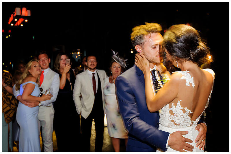 Brid egroom embrace during first dance at Royal Myconian Resort wedding reception