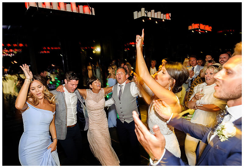 All the guests on the dance floor during Royal Myconian Resort wedding reception