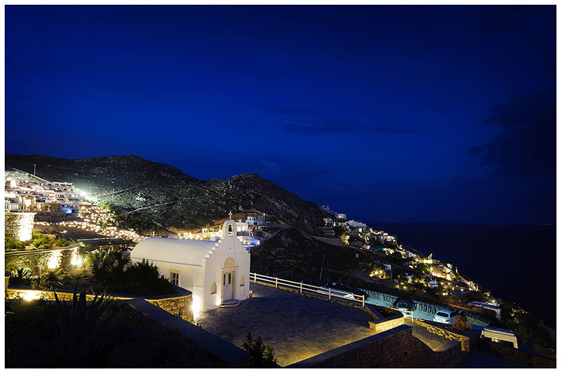Little white chapel at Royal Myconian Resort Mykonos at night