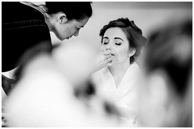 Favourite wedding photography 2018 bride closes eyes as she gets make up done