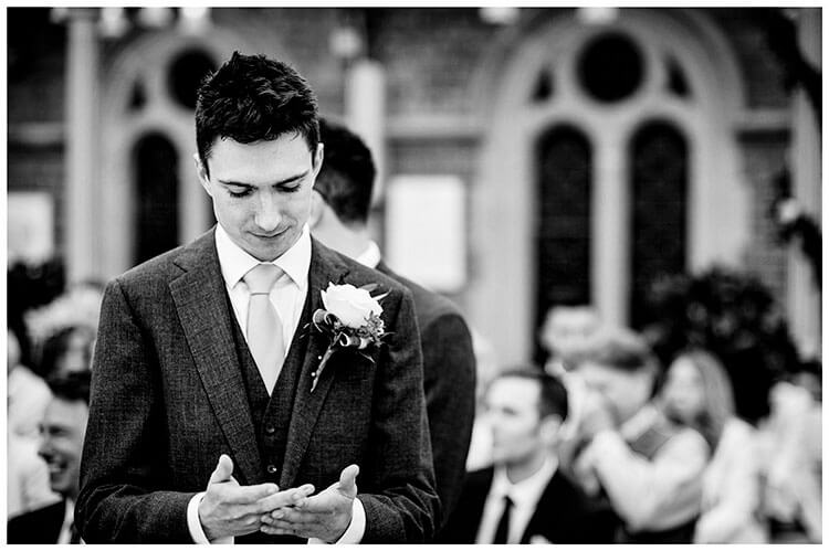 Nervous Groom checks palms prior to wedding ceremony at Kilworth House wedding