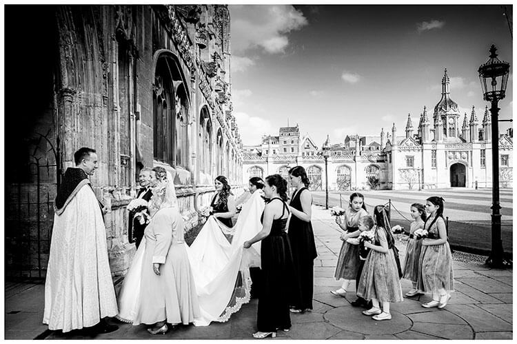 Wedding party arrives at Kings College Cambridge chapel greeted by Vicar favourite wedding photography 2018