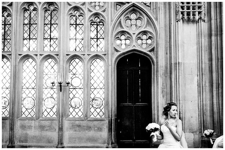 Bride holding bouquet inside Kings College Cambridge Chapel