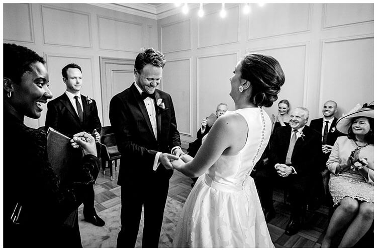 Bride groom laugh with their guests during Old Marylebone Town Hall wedding